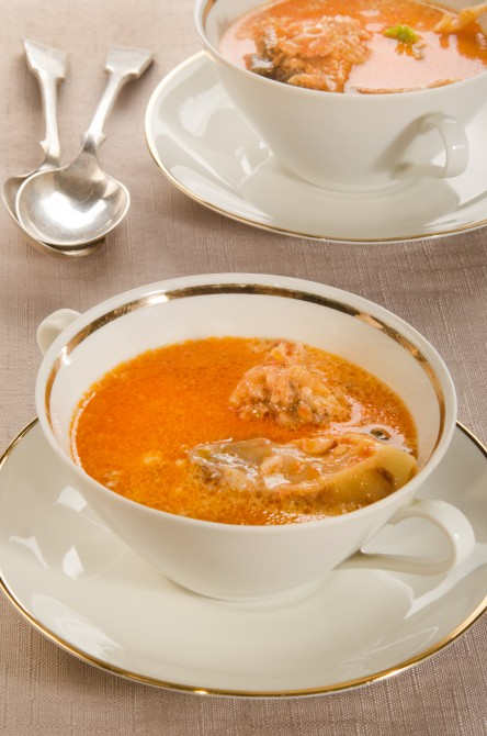 creamy carp soup with sour cream in a double handled soup bowl